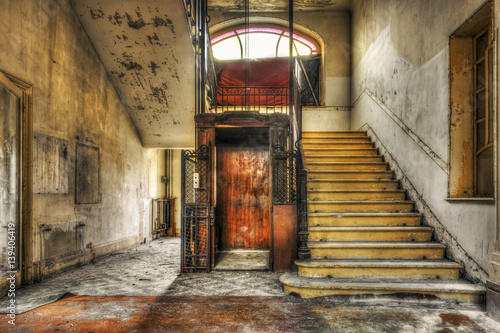 Fotografie, Obraz  Old vintage lift at abandoned hotel lobby