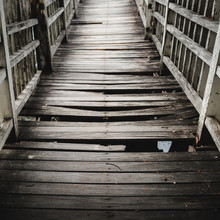 Old And Broken  Wooden Bridge Path Across The Lake/river,  Selective Focus