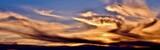 Fototapeta Tęcza - Incredible colors of ominous clouds in the desert sky at sunset in southern Arizona.