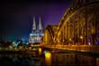 Kölner Dom bei Nacht in HDR mit Hohenzollernbrücke