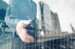 Businessman offering for handshake on city landscape blur background