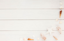 Frame Made Of Sea Shells On White Wooden Background. Flat Lay.