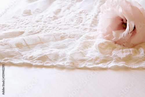 Photo  Background of white delicate lace fabric