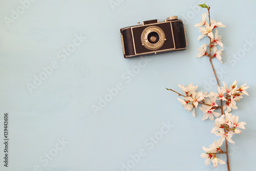 Fotografering  cherry blossoms tree next to old camera