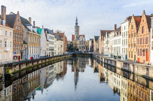 Foto op Canvas Brugge Reflection of church in Bruges, Belgium