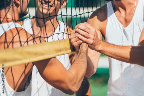 Beach volleyball players after match