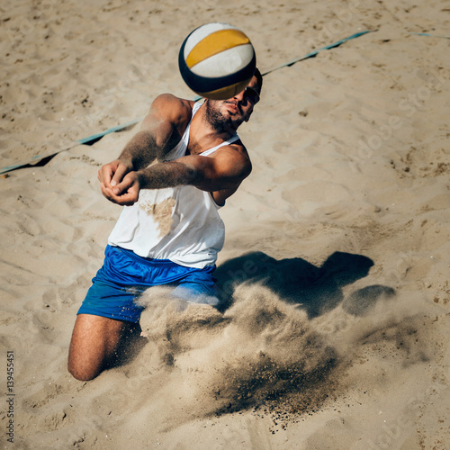 Male beach volleyball player in action