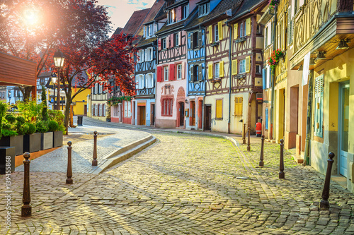 Foto op Canvas Oude gebouw Colorful medieval half-timbered facades with paved road in Colmar