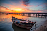 Beautiful sunset landscape sunset on the sea beach with a boat at Bangpra beach chonburi,thailand
