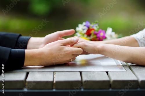 Fotografie, Obraz  Bride and groom holding their hands