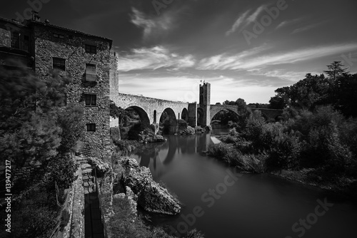 Foto op Canvas Begraafplaats Ancient gothic bridge in Besalu , Catalonia,Spain