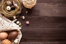 Happy Easter. Easter Eggs And Easter Decoration On The Wooden Table