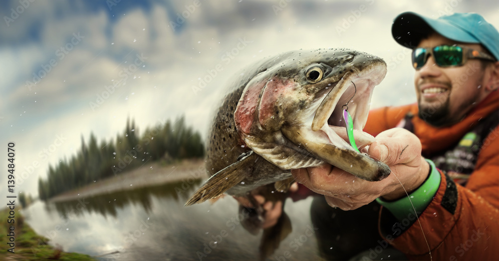 Fototapety, obrazy: Fishing. Fisherman and trout.