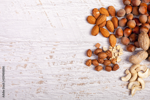 Different nuts on wooden background