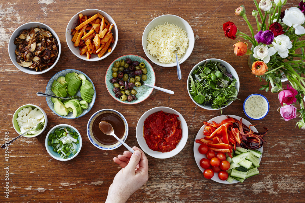 Fototapety, obrazy: variety of salads in bowl hand with spoon taking brown sauce