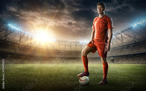 Fotografie, Tablou  footballer on a soccer field