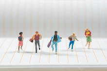 Businee Miniature People Running On Notebook Line