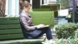 Young attractive businesswoman using laptop on a break outdoors