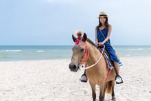 Woman Riding Horse In Sand Beach