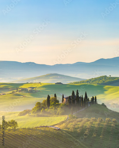 Photo Stands Blue sky Beautiful foggy landscape in Tuscany, Italy