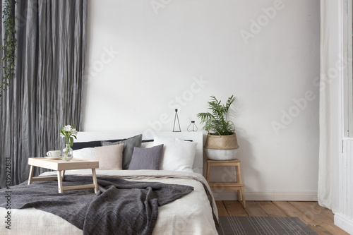 Fotografia  Interior of white and gray cozy bedroom