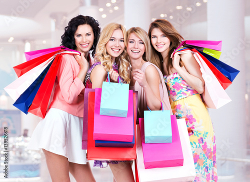 Fototapeta Happy young group of women  after shopping in the big mall obraz