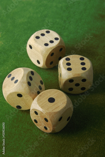 фотография  closeup of the dices on green table