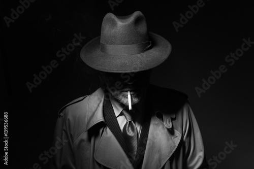 Fototapety, obrazy: Noir film character smoking a cigarette