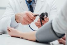Doctor Measuring Pressure