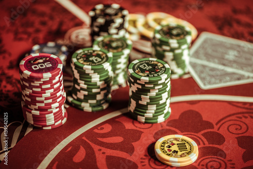 top view of poker chips on table in casino плакат