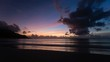 Timelapse sequence of a colorful beach sunset at Beau Vallon Bay, Mahe, Seychelles in 4K