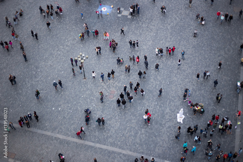 Aerial view on people at square.