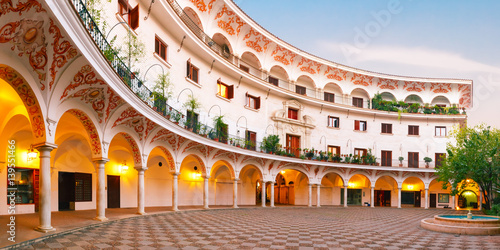 Fotomural Panorama of picturesque square plaza del Cabildo in the morning, Seville, Spain