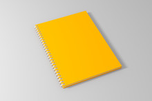 Blank Empty Yellow Spiral Notebook Template On Clean White Background. 3d Illustrated