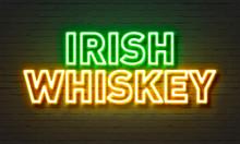 Irish Whiskey Neon Sign On Brick Wall Background.