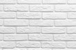 Leinwandbild Motiv Abstract weathered texture stained old stucco light gray white brick wall background, grungy blocks of stonework technology color horizontal architecture wallpaper
