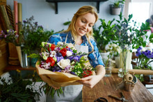 Happy Florist With Beautiful Bouquet