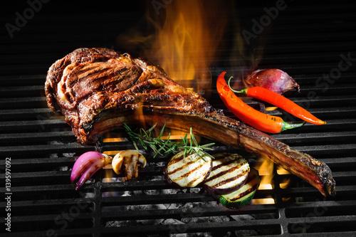 Aluminium Prints Grill / Barbecue Tomahawk rib beef steak on grill