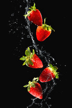 Strawberries In Water Splash