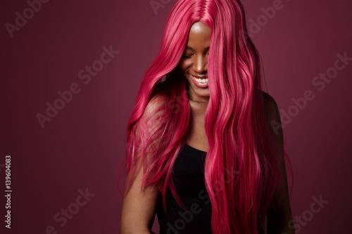 Fotografie, Obraz mixed race black woman with pink hair happy smiling