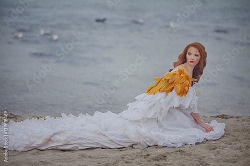 Poster Cygne beautiful girl like a swan on the beach