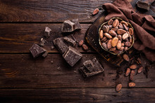 Cocoa Beans And Chocolate On W...