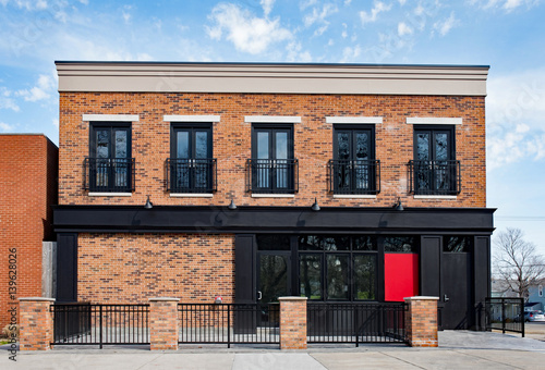 Fotografie, Obraz  Brick Commercial Building with Black Accents