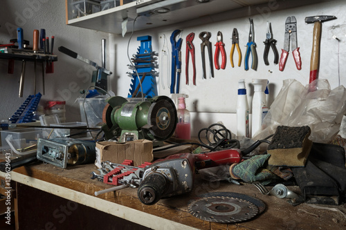 Fotografie, Obraz  Messy workshop, complete chaos on workbench, unorganised basement or garage