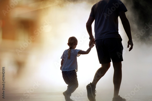 Fototapeta man runing / rescue wiith child from fire