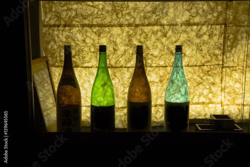 Backlit Colorful Glass Sake Bottles