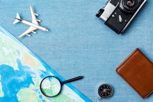 Travel Accessories On Blue Knitted Background, Travel Concept. Top View