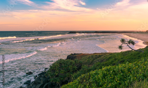 The Pinky sunset in summer time on the beach in Ballina, Byron bay, Australia Poster Mural XXL