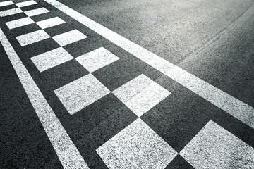 Sunny finish and start pattern line on the asphalt race road.