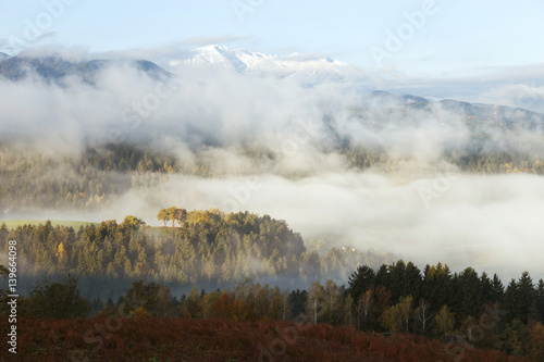 Beautiful Sunny Morning Foggy Landscape With Snowy Hills In The Background.  Picture Was Taken In Slovenia, Eu.